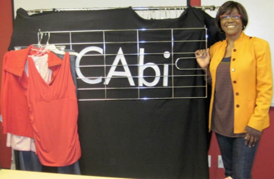 Novelett next to the Cabi Logo and the oodles of clothes she brought